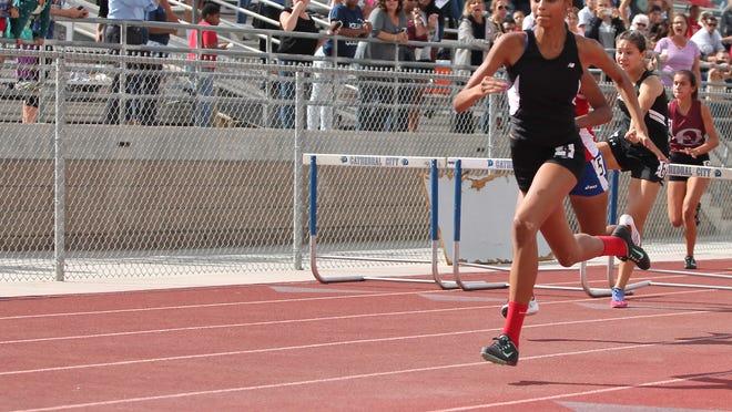 Palm Springs freshman Jada McLean, wins the girls 100 meter hurdles on Friday in the DVL Finals.