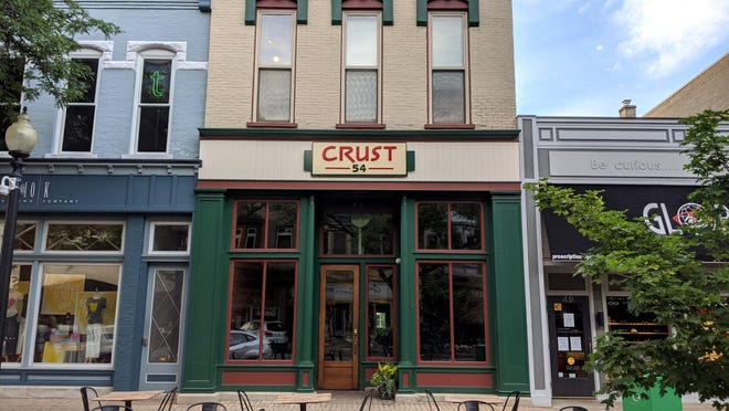 Crust 54, previously located at 54 E. Eighth St., opened in its new location on Monday, June 15.