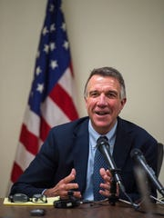 Gov.-elect Phil Scott answers questions during a news
