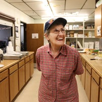 Lorraine Bentzler, 83, scoops egg salad onto bread while volunteering at the Eagle's Club in Marshfield on May 2, 2016. Bentzler has Alzheimer's disease but comes at it with confidence.