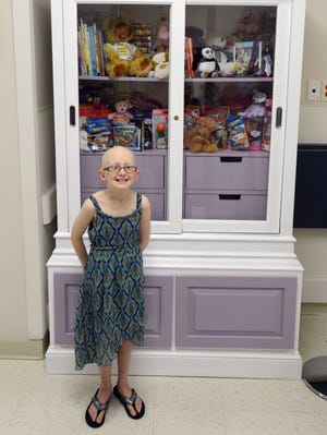 "Brooke Mulford, who was diagnosed with neuroblastoma, an aggressive form of cancer in 2009, recently unveiled ""Brooke's Toy Closet"" at Peninsula Regional Medical Center. The special cabinet is filled with toys, coloring books and other goodies that the emergency department and pediatrics unit can give to children who are hospitalized."