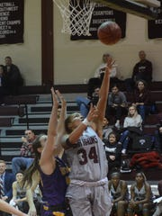 McMurry's Skyler Reyna goes up for a layup while being