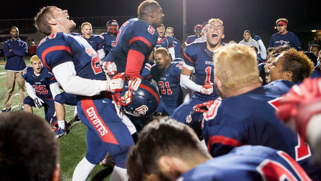 Peoria Centennial players celebrate after shutting out  Scottsdale Chaparral in the Division II semifinals Nov. 21, 2014 at Phoenix North Canyon.