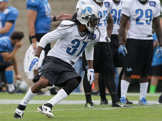 Detroit Lions cornerback Rashean Mathis runs through drills during an NFL football training camp in Allen Park, Mich., Tuesday, Aug. 5, 2014. The Lions appear to be thin on talent at cornerback, counting on veteran Mathis and second-year pro Darius Slay in the starting lineup. (AP Photo/Carlos Osorio)
