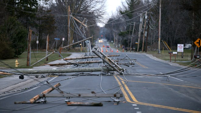 Utility poles litter Hard Road in Webster after a powerful windstorm hit the area on March 8, 2017.