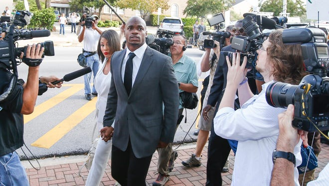Minnesota Vikings running back Adrian Peterson enters the Montgomery county courthouse for his arraignment Wednesday.