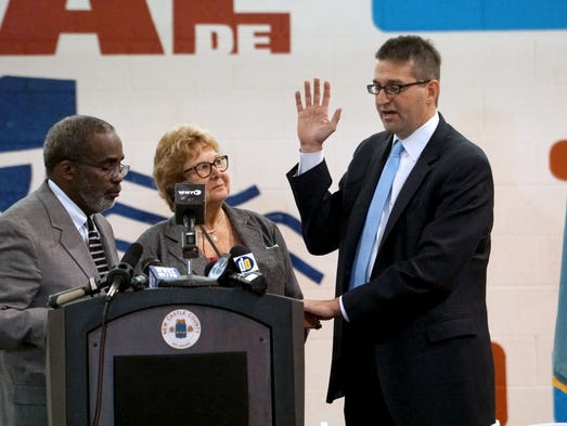 Honorable Judge Charles H. Toliver (left) administers
