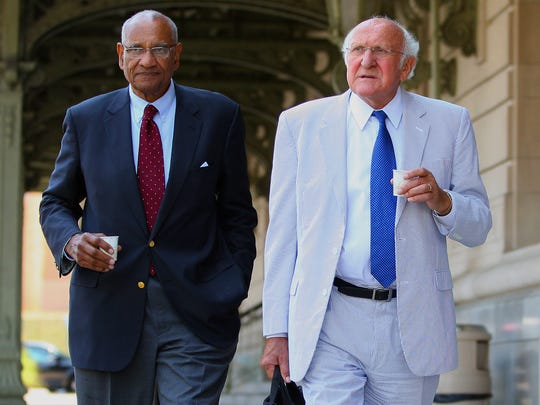 Jesse Arnelle (left) broke racial barriers at Penn State as a student, then was a longtime member of its board of trustees -- including when it fired Joe Paterno. Here, he walks with fellow member Steve Garban as they leave the Radison Hotel in Scranton after the Freeh Report was released in 2012.