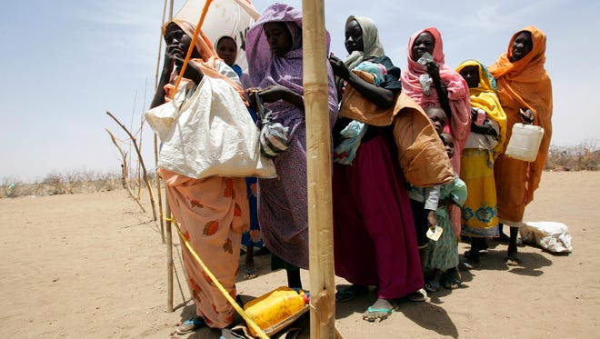 A group of Sudanese women line up for food at the Internally Displaced Person Kalma camp near Nyala, Sudan.