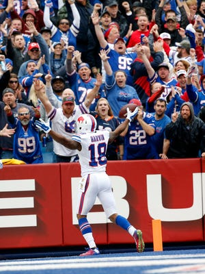 Buffalo Bills wide receiver Percy Harvin (18) and fans celebrate Harvin's touchdown catch during the first half against the Indianapolis Colts on Sunday.