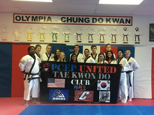 Members of the P-CEP United Tae Kwon Do club include (from left) Kenneth Lewis, Austin Martin, Scott Green, Katherine Springer,  Andrea Herrmann,  Maria Ballas, Matthew Kight, Master Alexander Covert (head coach),  Lukas Herrmann, Maya Tiller, Lubna Farhat, Cody Deems, Rafael Marquez and Jack Ruhula.
