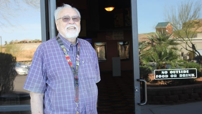 Ernie Hoffman stands outside the Redd Hills Cinema on its last day of business.
