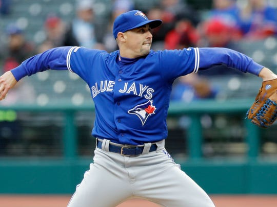 Toronto Blue Jays starting pitcher Aaron Sanchez delivers in the first inning of a baseball game against the Cleveland Indians, Thursday, April 4, 2019, in Cleveland. (AP Photo/Tony Dejak)