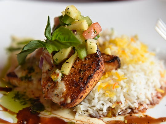 Cafe Renaissance is one of several places couples can go for a romantic Valentine's Day dinner. Pictured here is blackened swordfish topped with basil-mango chutney is served on a bed of saffron basmati rice and seasonal vegetables prepared by chef Ahmed Reza Rakhshani at The Cafe Renaissance in Waite Park for last year's Valentine's Day.