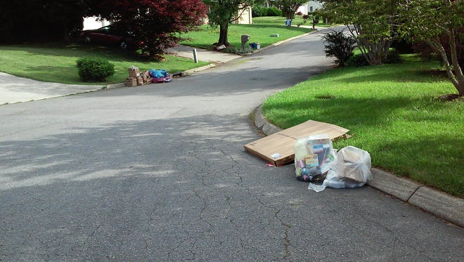Trash is left uncollected in the Green Meadows neighborhood in East Asheville.