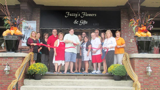 he Marion Area Chamber of Commerce Ambassadors, staff, family and guests enjoyed cutting the ribbon at Fuzzy's Flowers, Gifts, and Tuxedos, 297 Mount Vernon Ave., Marion. Mitchell Hutchman became the owner in June.Fuzzy's has floral designs for all occasions and also offers Elite Tuxedo rentals with over 150 styles to choose from. The shop is open from 9 a.m. to 5 p.m., Monday through Friday and from 9 a.m. to 12 p.m. on Saturday.
