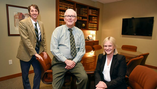 Attorneys John Mathews, Tom Mathews, Kelly Larson of Hughes Mathews Greer, P.A., shown Wednesday, Sept. 12, announced they will be merging with Minneapolis-based Gray Plant Mooty.