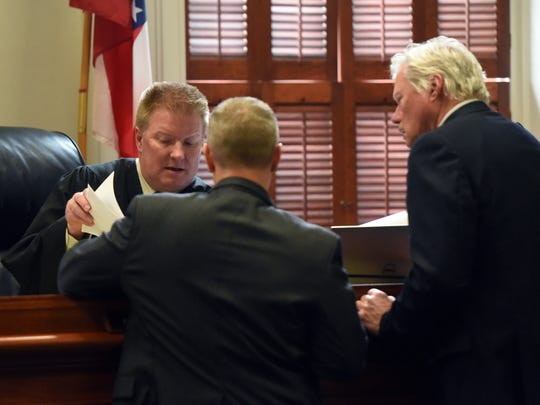 Judge Mike Ater, left, talks to Ross County Prosecutor Matt Schmidt, center, and Jim Boulger, Donnie Cochenour Jr.'s attorney, during day three of Cochenoeur's murder trial Thursday in Ross County Common Pleas Court.