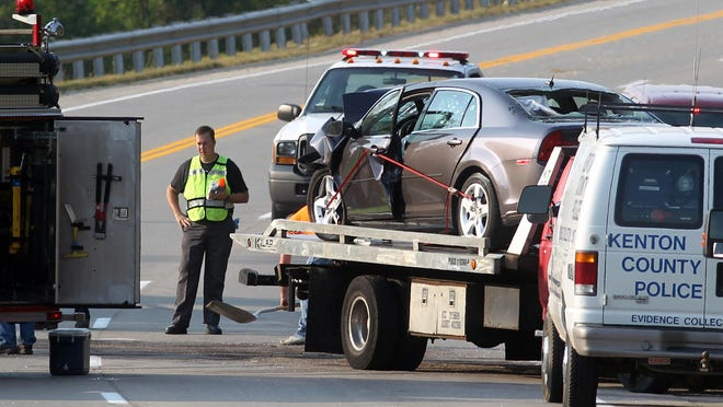 A wrecker hauls off one of two vehicles involved in the Sept. 1 head-on collision in Fort Wright in which four people were killed.