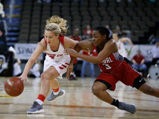 Boyd County's Savannah Wheeler, left, and Manual's Jaela Johnson, 3, chase down a loose ball during a quarter final game in the St. Elizabeth Healthcare/KHSAA Girls' Sweet 16 basketball tournament played at BB&T Arena in Highland Height, Ky. Friday March 9, 2018.