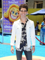 Cameron Boyce was all smiles at the premiere of 'The Emoji Movie.'