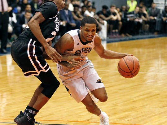 Southern Mississippi guard Cortez Edwards, right, dribbles past Mississippi State guard Tyson Carter (23) in the second half of an NCAA college basketball game in Jackson, Miss., Saturday, Dec. 23, 2017. (AP Photo by Rogelio V. Solis)