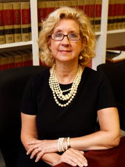 Laura Barbieri, an attorney with Advocates for Justice, is photographed in her office in Manhattan, Aug. 25, 2015.