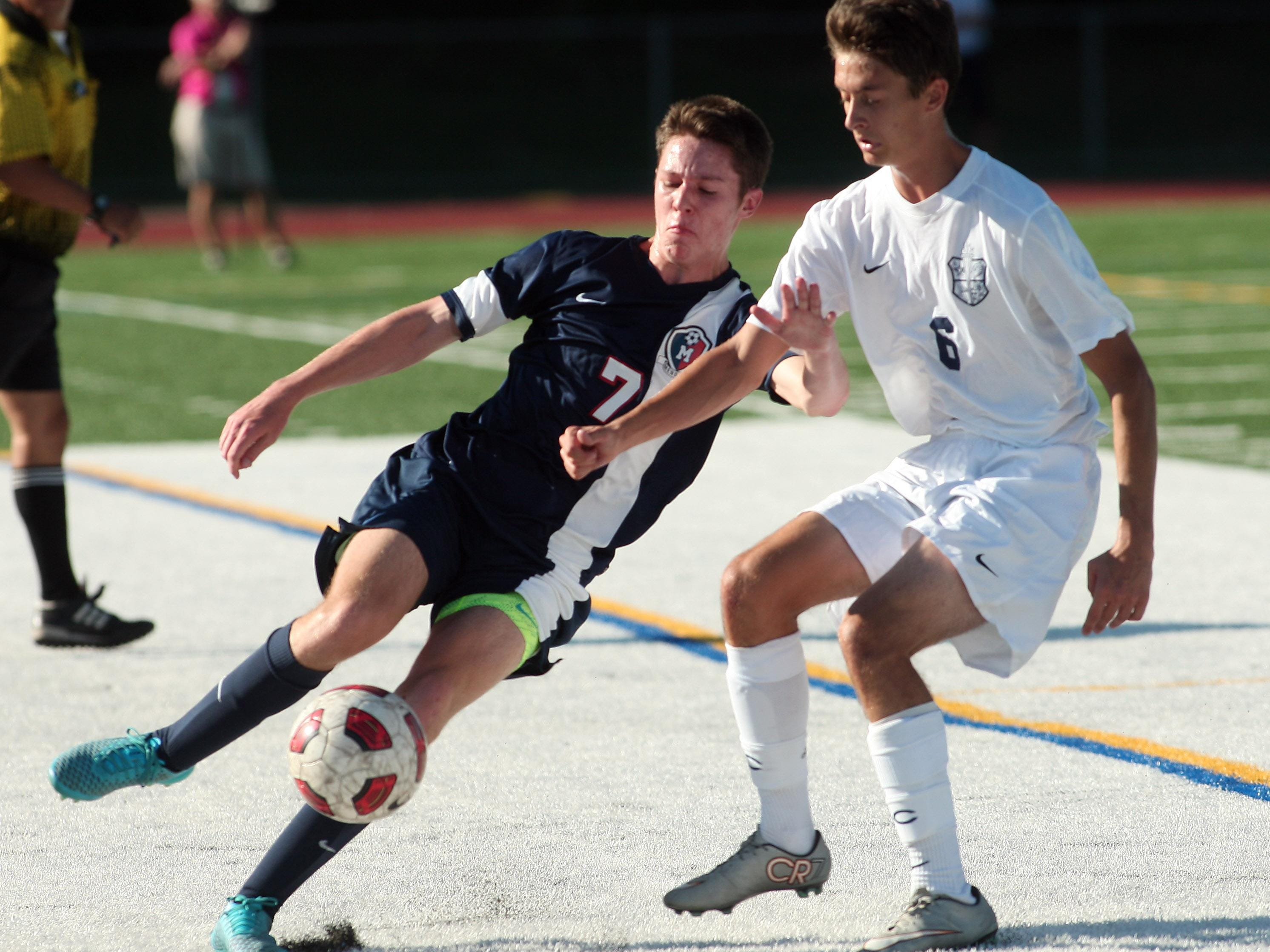Mendham's Zach Saliterman clears the ball from Chatham defender Brian Guimond during their NJAC-United boys soccer matchup Wednesday.