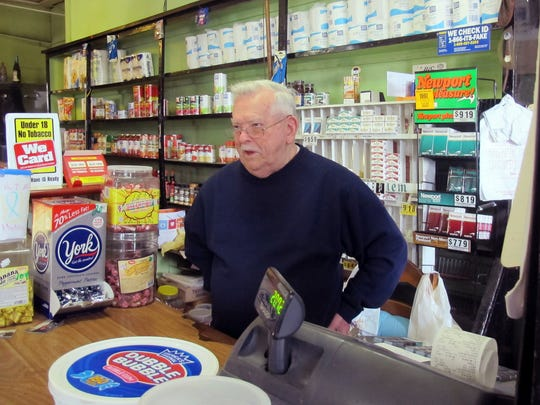 In this Oct. 1 photo, Donald Bedard stands at the counter of his Bedard's Cash Market, which he has operated for 43 years, in what has become one of the high-crime neighborhoods in Rutland. Bedard said steps have been taken to combat the problem with heroin and other opiate drugs in the city, and things are improving.