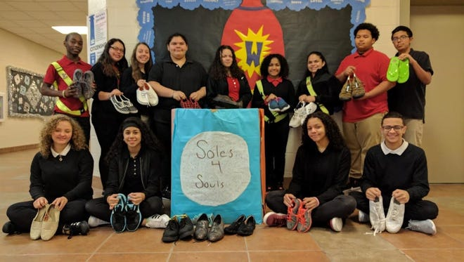 Members of Wallace Middle School's National Junior Honor Society collected 211 pairs of footwear for Soles4Souls for Haiti.