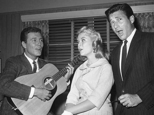Roger Smith, far left, Carolyn Komant and Efrem Zimbalist