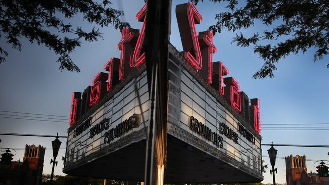 Do you know which Monroe County community the Strand Theater is located in?
