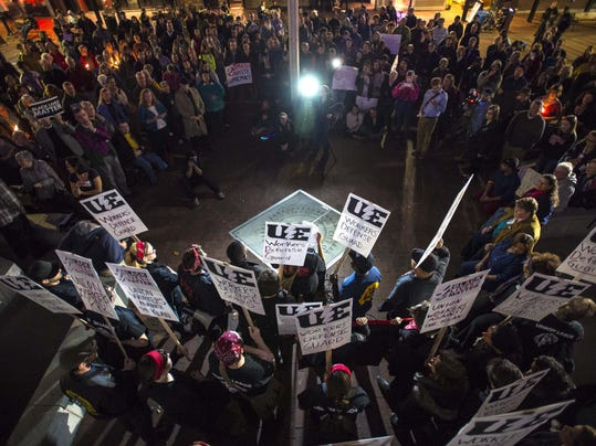 Demonstrators gather at City Hall for a rally after marching down Church Street in Burlington on Thursday, November 5, 2015, in response to Ku Klux Klan fliers that were placed at the homes of two residents of color in the city. (Photo: GLENN RUSSELL/FREE PRESS)