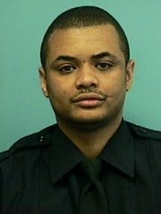 This undated photo provided by the Baltimore Police Department shows Detective Sean Suiter. Suiter was shot in the head with his own gun Nov. 15, 2017, in a particularly troubled area of west Baltimore while investigating a 2016 triple homicide. His unsolved murder has transformed into a feeding frenzy of speculation in a city filled with armchair sleuths and a suspicious view of law enforcers.