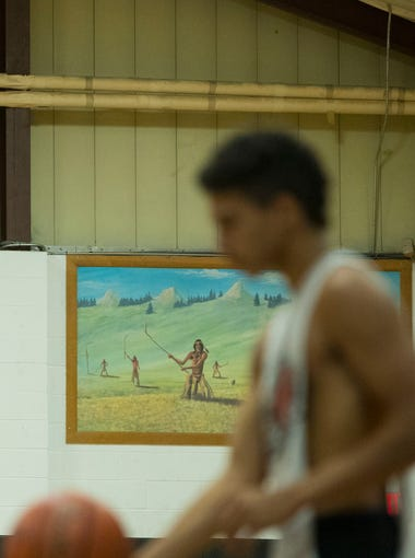 """Alejandro Rama practices at the Red Cloud High School gym on Tuesday, July 17, 2018. Rama says he has a """"warrior mindset"""" when playing basketball. The game gives him an opportunity to represent his people."""