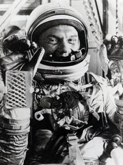 "Astronaut John Glenn, a Cambridge native, gives the ""thumbs up"" sign in this file photo from NASA."