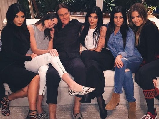 Bruce Jenner, center, with his Kardashian daughters.