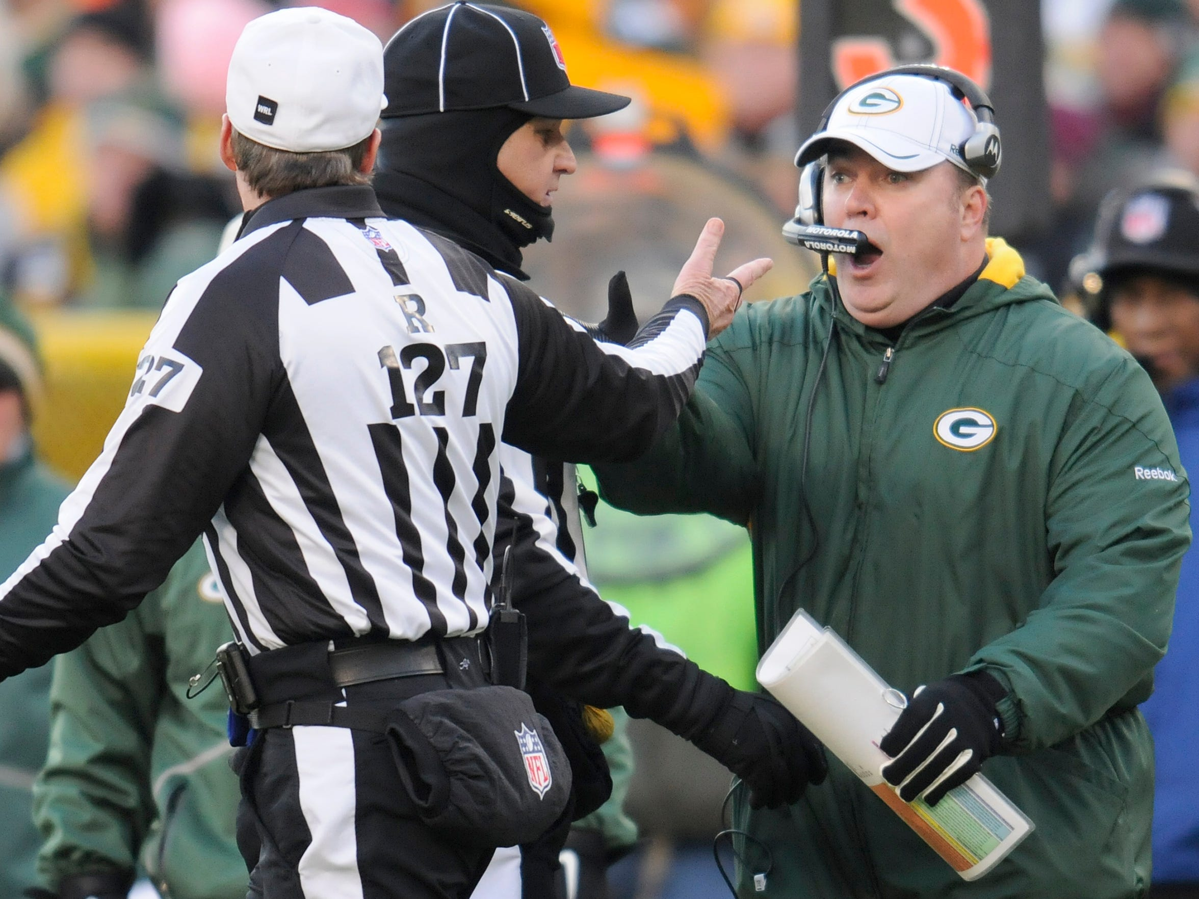 Green Bay Packers head coach Mike McCarthy, right, protests a fumble call in the first quarter against the New York Giants during the NFC divisional playoff game at Lambeau Field in Green Bay on Sunday, Jan. 15, 2012.
