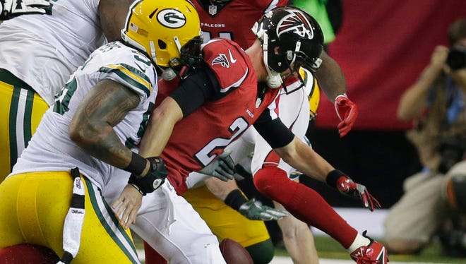 Green Bay Packers outside linebacker Julius Peppers (56) stops  Atlanta Falcons quarterback Matt Ryan (2) as the Falcons tried for a 2 point conversion after their touchdown during the Green Bay Packers NFL game against The Atlanta Falcons, Sunday, October 30, 2016 at the Georgia Dome in Atlanta Georgia.