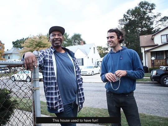 """Vincent Thomas (left), former homeowner of """"The White House"""" in Detroit, stands with artist Ryan Mendoza."""