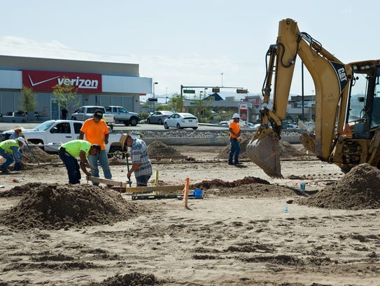 Highland Enterprise employees lay out footing for the