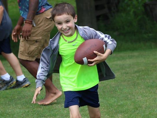 Mason Deppiesse, of Cedar Grove, plays a game of backyard