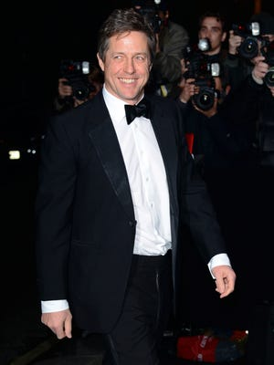 Hugh Grant, here in London in November 2013, has become a father for a third time, British media say.