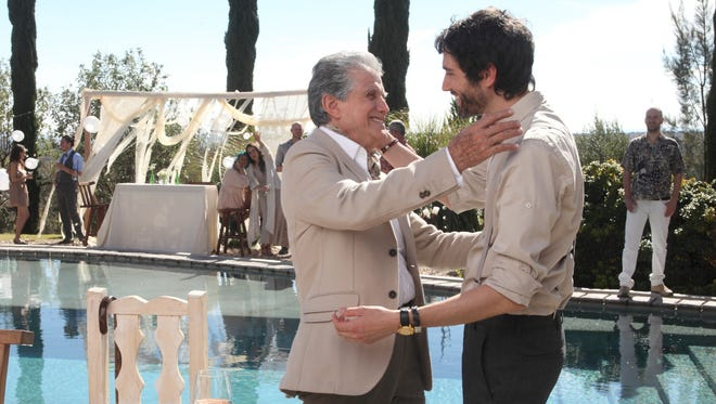 "Father (Hector Bonilla) and son (Benny Ibarra) enjoy a light moment in ""Un Padre No Tan Padre."""