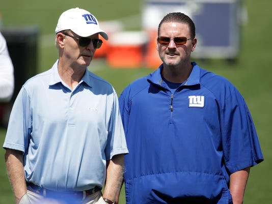 New York Giants head coach Ben McAdoo, right, talks to team owner John Mara during NFL football practice, Wednesday, Aug. 23, 2017, in East Rutherford, N.J. (AP Photo/Julio Cortez)