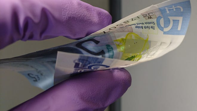 A laser appearing on physical currency.