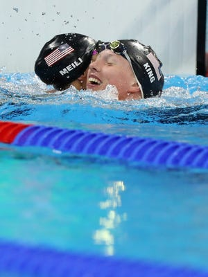 Gold medal winner United States' Lilly King, right, celebrates with bronze medal winner United States' Katie Meili after the final of the women's 100-meter breaststroke during the swimming competitions at the 2016 Summer Olympics, Monday, Aug. 8, 2016, in Rio de Janeiro, Brazil. (AP Photo/Lee Jin-man)