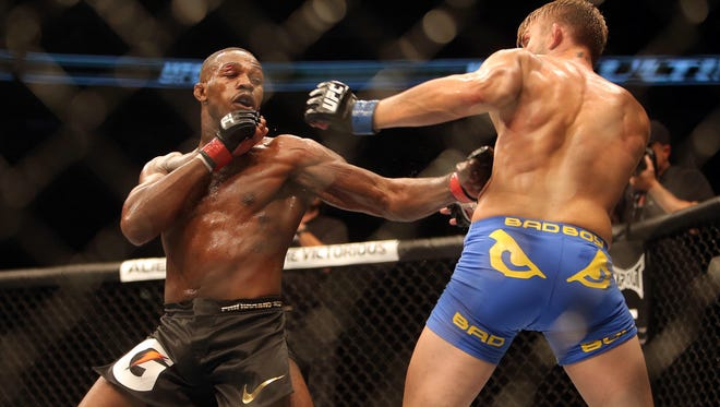 Union-Endicott's Jon Jones fights Alexander Gustafsson during their light-heavyweight championship bout at UFC 165 on Sept. 21, 2013. Jones won a five-round decision.