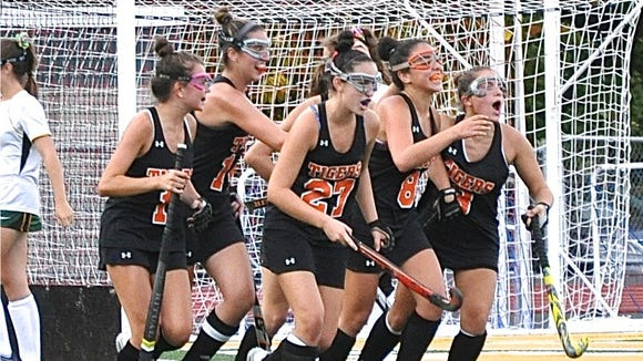 Mamaroneck celebrates goal by Alex Lepore (No. 8).