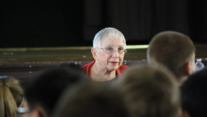 Holocaust survivor Susie Fono tells her story of survival and loss to students at Washington Junior High on April 20.